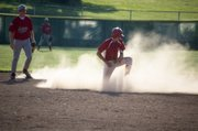 Jake Stauch emerges from a cloud of dust after stealing second base in the bottom of the second inning of Post 41's 13-3 victory over Geiger Friday night.