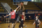 Dylan Jacobs contests a Lansing shot attempt on June 23 at the Rockhurst summer league.