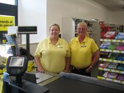 Dollar General worker Kacee Sybrant (left) and manager Virginia Weeks are two of the new Basehor store's employees. The store opened the first week of July to the delight of Basehor officials and the Dollar General
