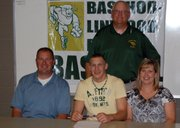 Basehor-Linwood senior Ryan Lawless recently signed a letter of intent to play college baseball at Hutchinson Community College. Pictured at the signing ceremony are, seated (from left): Joe Lawless, father; Ryan Lawless; Angie Lawless, mother; and, standing: BLHS baseball coach Dave Svoboda.