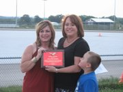 Melanie Morris, right, accepts the Spirit of the Year award Saturday from Chamber Vice President Deb Taylor.