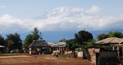 Mount Kilimanjaro towers over a nearby village in Tanzania. Kilimanjaro stands 19,341 feet high and is the highest free-standing mountain in the world.