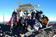 The climbing team and support staff celebrate at the summit of Mount Kilimanjaro on June 11, 2010.