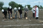 The board of elders for the Risen Savior Lutheran Church break ground Sunday on the site of what will be the churchs new building. Picture are (from left) Howard Kalebaugh, Bernie Bernthal, Steve Woelk, Terry Wade, Jerry Frese, and the Rev. Robert Weinkauf.