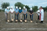 The building committee for the Risen Savior Lutheran Church break ground Sunday on the site of what will be the churchs new building. Picture are (from left) Darrell Hall, Trevor Stubbs, Randy Wiehe, Steve Mariano, Tim Selbe, Gene Saving, Kaleb Weinkauf, crossbearer, and the Rev. Robert Weinkauf.