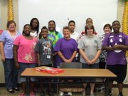 The reading tutoring program at the library this summer consisted of several volunteer leaders. Pictured are: front row, from left) DaNa'e Banks, Jamison Freese, Rachel Sheeley, Rachel Schmitz, and John Carter (back row, from left) Carol Schmitz, Kyliea Jarrett, Jaelynn Freese, Tyrese Bolton, Tre Scott and Debbie Roberts.