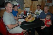 "In honor of the ""Ultimate Destroyer's"" television debut on Man v. Food, several groups visited Papa Bob's Wednesday and ordered the massive sandwich. Sharing the sandwich are Gates Brown, front left, Marty Brown, back left, Laura Garrison, back right, John Garrison, front right, and Anna Brown, far front."