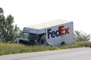 A Federal Express truck involved in a two-car accident Thursday morning, Aug. 19, 2010, on westbound Kansas Highway 10 near De Soto rests off the shoulder of the highway. The truck was struck nearly head-on approximately 8 a.m. by a Ford Escort that crossed the median from the eastbound lane. The female driver of the Escort was killed and the male driver of the truck was transported to an area hospital for injuries, including a broken leg. Kansas Highway Patrol expects the section of westbound K-10 to remain closed until at least noon.