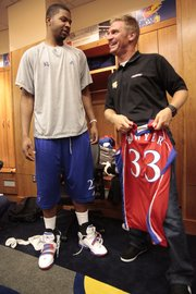 Marcus Morris and NASCAR driver Clint Bowyer, visit after Bowyer was given a KU Jersey on Tuesday August 24, 2010, while Bowyer was in town at KU promoting the upcoming race at the Kansas Speedway in October.