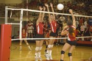 THS sophomores Hannah Kemp and Jenny Whitledge rise up to try and stop an Atchison attack Tuesday night in the Chieftains' home win.