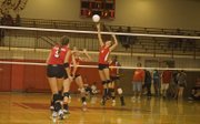 Sagan Scates makes a play above the net for Tonganoxie in the Chieftains' home win against Atchison Tuesday night.