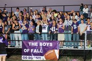 Baldwin High School students cheer on their football team at Friday's season-opening contest in Paola. The Bulldogs won 32-14 over the Panthers.