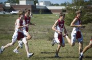 Tonganoxie High cross country runners Brady Field, Jeff Neal, Andrew Behm and Keith Slater head out of the gates in the boys 5K race Friday.
