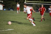 Tonganoxie High freshman Evan Stilgenbauer pushes the ball forward in Tonganoxie's 2-1 home loss to Atchison on Tuesday.