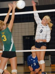 Mill Valley freshman Molly Oshinski (9) pounds a kill against Basehor-Linwood's Sydne Eriksen during a Thursday volleyball triangular at MVHS.