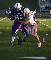 THS linebacker Jonas Myers tries to bring down Piper's Julian Cole in the Chieftains' 14-13 loss Saturday night.