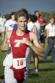 THS senior Keith Slater begins to make his final turn toward the finish line on Tuesday at the Tonganoxie Invitational.