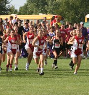 Tonganoxie High's girls cross country team begins its race on Tuesday at the Tonganoxie Invitational, where the Chieftains finished seventh in the team standings.