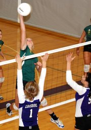 Basehor-Linwood junior Cara McCarty soars for a kill during the Bobcats' match against Louisburg at the Louisburg Tournament. BLHS finished in third place.