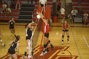THS senior Molly O'Hagan stymies a Lansing spike on Tuesday night. The Chieftains lost to LHS in straight games at a home triangular.