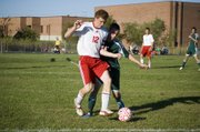 Tonganoxie High captain Zach Tallent keeps a Basehor-Linwood forward on his back in the second half of the Chieftains' 3-2 home loss on Wednesday.