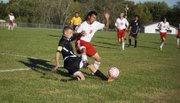 THS junior Joseph Parrino has the ball taken away from him in the second half of Tonganoxie's 8-1 home loss to Bishop Ward on Thursday.