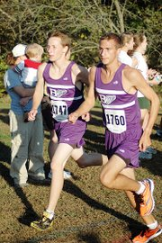 Baldwin High School freshman Ethan Hartzell, left, and junior Brian Wright run together Thursday at Rim Rock Farm. Wright and Hartzell finished third and fourth at the Frontier League meet.