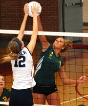 Basehor-Linwood&#39;s Samantha Rutherford battles St. James Academy&#39;s Katie Dulek for a ball at the net during the Bobcats&#39; loss in the substate tournament.