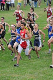 Dalton Harrington runs with a large pack of cross country runners at a regional Saturday afternoon before gaining separation and finishing 10th at the event. Harrington and the THS boys finished third, which qualified them for state.