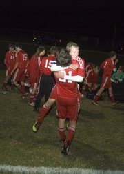 Tonganoxie captain Matt Briggs gets a big hug after the Chieftains' 2-1 road playoff victory Tuesday night at Basehor.