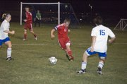 Matt Briggs clears the ball for the Tonganoxie High defense in the first half of the Chieftains' 2-1 road playoff win Monday night at Perry-Lecompton.