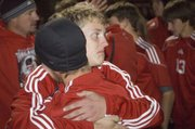 Tonganoxie High's Matt Briggs, right, and Quinten Olson embrace shortly after the boys soccer team's season came to an end in a regional final with a 5-4 overtime loss to Maur Hill-Mount Academy Friday at Atchison. The match went to a second round of sudden-death penalty kicks before the Ravens finally prevailed.