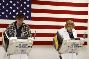 Mike and Nancy O&#39;Connor cast their ballots for the mid-term election on the electronic polls at the De Soto Community Center on Tuesday, Nov. 2. &quot;We always vote together and usually almost the same,&quot; said Nancy O&#39;Connor.
