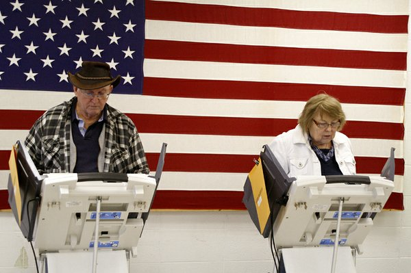 "Mike and Nancy O'Connor cast their ballots for the mid-term election on the electronic polls at the De Soto Community Center on Tuesday, Nov. 2. ""We always vote together and usually almost the same,"" said Nancy O'Connor."