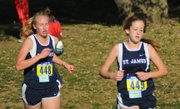 St. James Academy's Bridgette Westhoff, left, and Abbey York, compete at the Class 4A cross country state championships. They helped the Thunder finish ninth as a team.