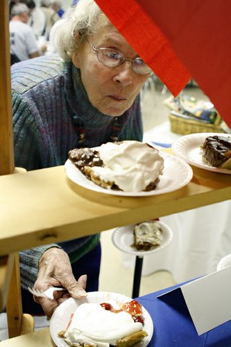 "Ruth Bowlin selects her dessert at the 74th annual Election Night Dinner at the De Soto Methodist church. ""I've been coming to these dinners since 1982,"" Bowlin said. ""I used to help cook but now I just come for the food after I vote."""