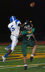 A Sumner Academy defensive back knocks the ball away from Basehor-Linwood receiver Ryan Murphy. Sumner beat BLHS, 36-22.