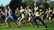 Basehor-Linwood's Ally Laney and Hannah Tush battle for position in the pack at the start of the Class 4A cross country state championships.