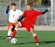 Bonner Springs defender Caleb Seaton challenges a Rose Hill player for possession of the ball during the first half of their Class 4-1A state semifinal game.