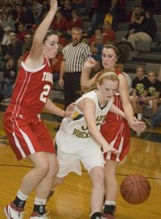 Basehor-Linwood's Victoria Smith splits the Tonganoxie defense during the Bobcats' 31-28 victory.