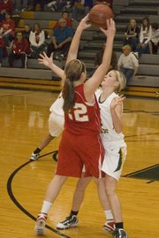 Cara McCarty, Basehor-Linwood junior, plays tight defense during the Bobcats' 31-28 victory against Tonganoxie.