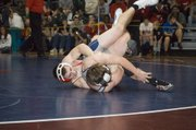 Nick Pursel rolls his Mill Valley opponent, Andrew Van Holland, to the mat on his way to a championship victory in the 160-pound weight class at the Eudora Tournament of Champions on Saturday.