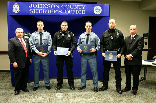 From left to right: Johnson County Sheriff Frank Denning, Deputy John Klingele, Deputy Evan Comerio, Sergeant Mark Rokusek, Sergeant Brent Moore and Undersheriff Kevin Cavanaugh at the county's annual recognition ceremony on Thursday, Dec. 16. Klingele, Comerio, Rokusek and Moore received the county's Life Saving Award for their rescue efforts of a six year-old De Soto boy confined to his mother's attic. Photo courtesy of the Johnson County Sheriff's Department.