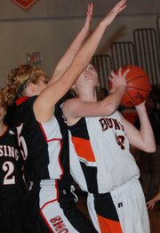 Bonner Springs sophomore  Anna Deegan attempts to score while being closely guarded during the Braves' loss to Lansing.
