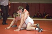 Justin Soetaert, Tonganoxie High 125-pounder, reaches for his opponent's arm in this Mirror file photo. Soetaert, a THS senior, was one of five Chieftains to finish in the top three at Saturday's Louisburg Invitational.