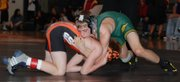Josiah Seaton, left, of Bonner Springs, and Sammy Seaton of Basehor-Linwood square off in the 103-pound finals Saturday at the Dick Burns Mat Classic. The cousins had a tough battle, but Sammy Seaton won with a 7-0 decision.