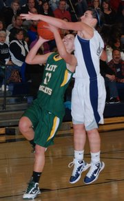 Basehor-Linwood's Courtney Poe draws a foul against Mill Valley. Poe scored 10 points in the Bobcats' 41-31 victory.