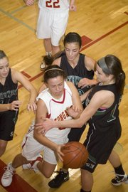 Tavia Brown goes after a loose ball as she is surrounded by Blue Valley Southwest Timberwolves Thursday in Tonganoxie&#39;s 53-45 loss.