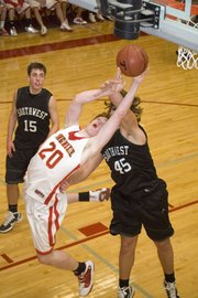 Dane Erickson gets fouled under the basket while going up for a shot in Tonganoxie's win over BVSW on Saturday.