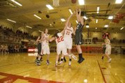 Tayler Miles goes up to defend a De Soto shot attempt in Tonganoxie's 30-29 opening-round loss at the tournament.